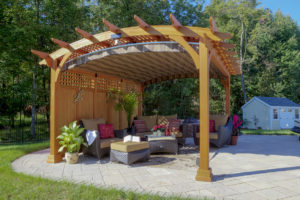 Decks Plus - Hearthside-Pergola,-Canyon-Brown-Stain,-Lattice-Roof,-Privacy-Wall,-East-Ridge-Cocoa-EZ-Shade-Canopy