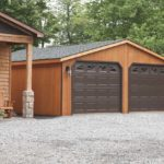 24x26 2 car cedar garage beside house